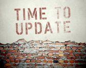 Time to update concept on old brick wall — Stock Photo