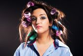 Funny woman portrait hair with curlers — Foto Stock