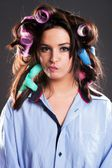 Funny woman hair with curlers — Stock Photo