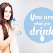 You are what you drink, woman with bottle — Stock Photo #48757191