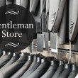 Gentleman store suits jacket on hangers — Stock Photo #48757305