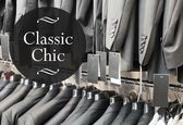 Classic chic, suits jacket in apparel store — Stock Photo