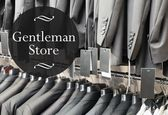 Gentleman store suits jacket on hangers — Stock Photo