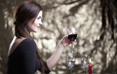 Elegant glamour woman with glass of red wine — 图库照片