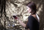 Elegant glamour woman with glass of red wine — Stockfoto