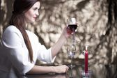 Elegant glamour woman with glass of red wine — Stock Photo