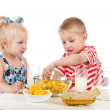 Kids having healthy breakfast. isolated on white background — Stock Photo #12329373