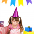 Girl blowing candles on her cake. isolated over white background — Stock Photo