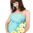 Stock Photo: Pregnant woman with a orchid. isolated on white background