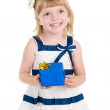 Girl holding gift box in hands — Stock Photo #12329660