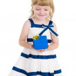 Girl holding gift box in hands — Stock Photo