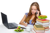Pretty female student with laptop, mobile phone and books working. isolated over white background — Stock Photo