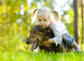 Young girl and dog — Stock Photo