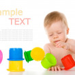 Child playing with educational cup toys — Stock Photo