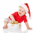 Baby boy in Santa hat with a gift. — Stock Photo