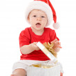 Baby boy in Santa hat with a gift. — Stock Photo #13833694