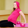 Pregnant woman practicing yoga — Stock Photo