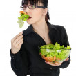 Portrait of businesswoman having fresh vegetable salad. — Stock Photo