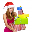Santa girl holding christmas gifts. isolated on white background — Stock Photo #13834236