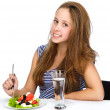 Young Girl Eating Vegetable Salad. isolated over white background — Stock Photo