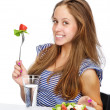 Portrait of a happy young lady eating fruit salad. isolated over white background — Stock Photo