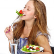 Girl holding a plate with salad. isolated over white background — Stock Photo