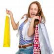 Young teenager holding shopping bags. isolated on white background — Stock fotografie