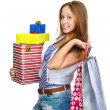 Shopping girl holding many shopping bags and box. isolated on white background — Stock Photo