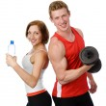 atlética mulher e homem com um dumbells. isolado no fundo branco — Foto Stock