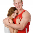 Happy sports pair of male and female embracing. isolated on white background — Stock Photo