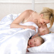 Happy family sleeping together on bed at home — Stock Photo #13834824