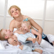 Royalty-Free Stock Photo: Happy family to bed in the bedroom