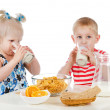 Kids having a healthy breakfast. isolated on white background — Stock Photo