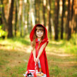 The girl in the wood with a basket in hands — Stock Photo