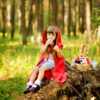 The girl in the wood eats pies — Stock Photo #13835115