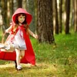 The girl runs on the wood. — Stock Photo #13835223