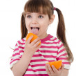 The girl eats orange. isolated on white background — Stock Photo