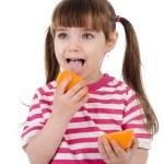 The girl eats orange. isolated on white background — Stock Photo