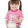 Stock Photo: Young girl holding a jug with milk. isolated on white background