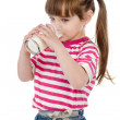 Portrait of a happy little girl drinking milk. isolated on white background — Stock Photo