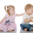 Stock Photo: Little girls calm the boy. isolated on the white background