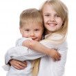 Stock Photo: Smiling young brother and sister. isolated on white background