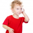 Stock Photo: Boy talking on cell phone. Isolated on a white background