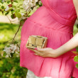 Pregnant girl with a calendar — Stock Photo