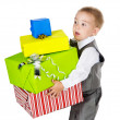 Little boy holding many gifts in arms. isolated on white background — Stock Photo
