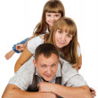 Royalty-Free Stock Photo: Happy family playing at home, lying heaped on floor. isolated on white background