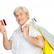 Old woman with shopping bags and credit card. isolated on white background — Stock Photo