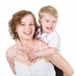 Stock Photo: Mother giving her son piggyback ride. isolated on white background