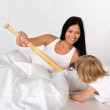 Mother and her daughter in bed having fun — Stock Photo