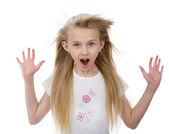 Surprised little girl with fluttering hair — Stock Photo
